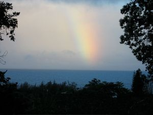 "An intense ""chunk"" of rainbow over the ocean"