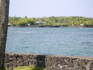 Photo of the entrance to Champagne Ponds taken from across the ocean at Dragon's Point