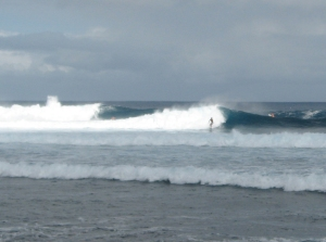 A surfer catches a wave at Pohoiki Monday afternoon 8/11/09