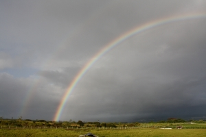 The left side of a full arc double rainbow created by remnants of Felicia