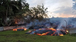 CNN: Lava burns vegetation as it approaches a property boundary early on the morning of Tuesday, October 28. A lava flow from the volcano Kilauea is advancing on the community of about 950 people on Hawaii's Big Island. By early Tuesday, the flow was about 70 yards (64 meters) from the closest home and moving to the northeast at 8 to 11 yards (7-10 meters) per hour, the Hawaiian Volcano Observatory said.